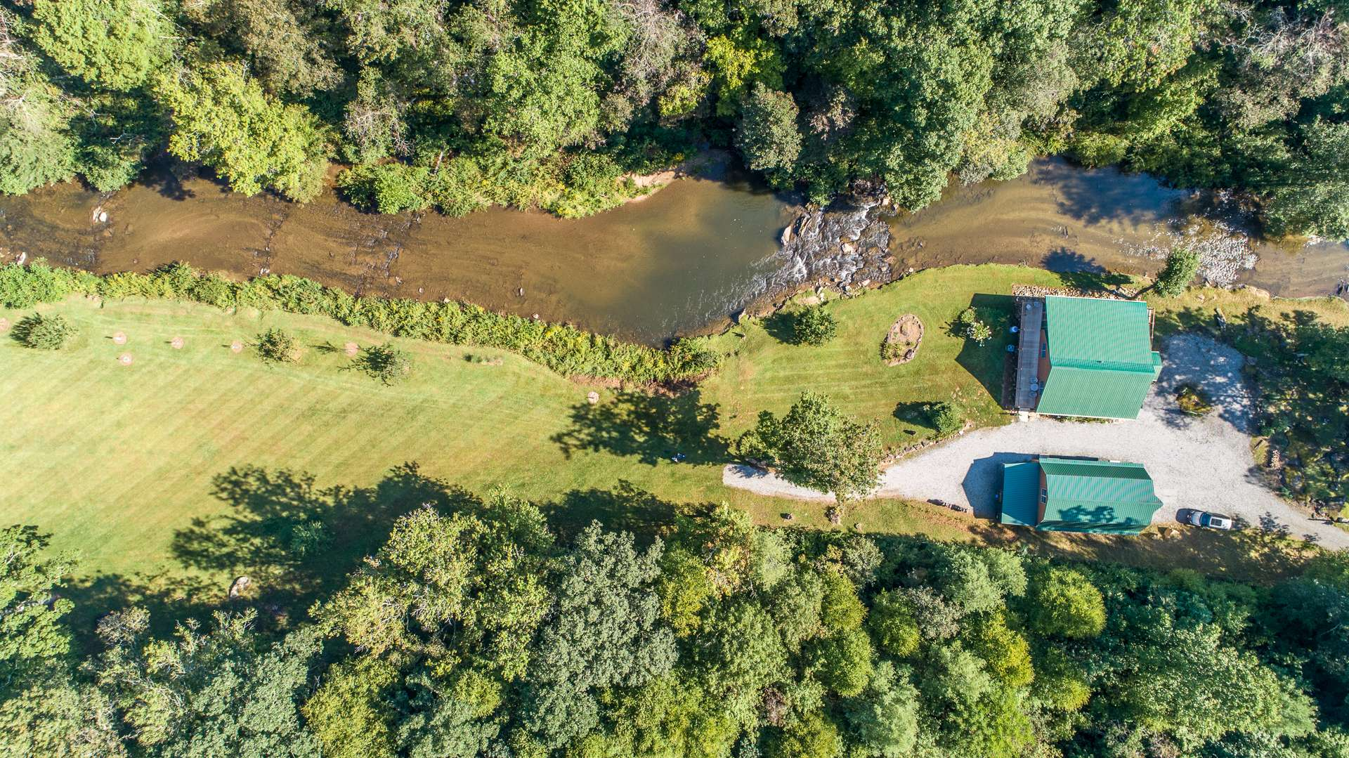 The acreage offers a nice mixture of open and fenced pastures, and serene woodlands offering multiple building sites, ATV trails, and abundant wildlife creating the perfect fishing and hunting retreat, or great horse property.