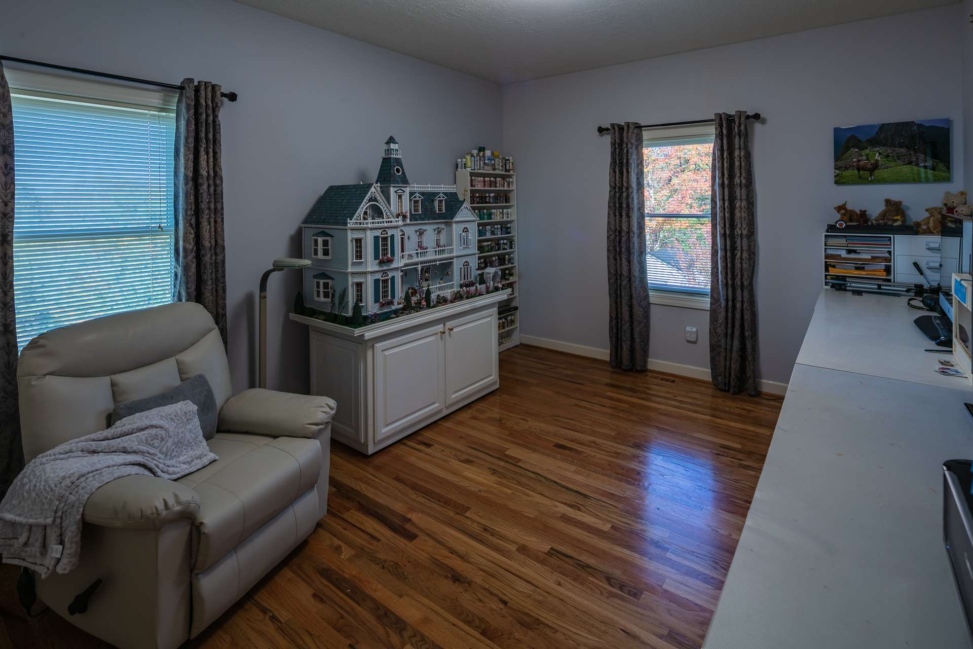 The main level offers a nicely sized bedroom with wood floors and a private bath.  This could be an option for the master suite.  The current owners use this space for artistry and creativity.