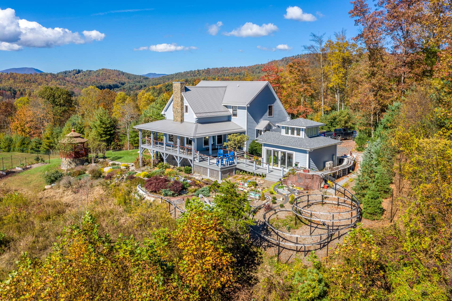 Gated and secluded, this craftsman style home is perched upon a magnificent 24+ acre setting  in the Laurel Springs area of the Blue Ridge  Mountains of North Carolina.