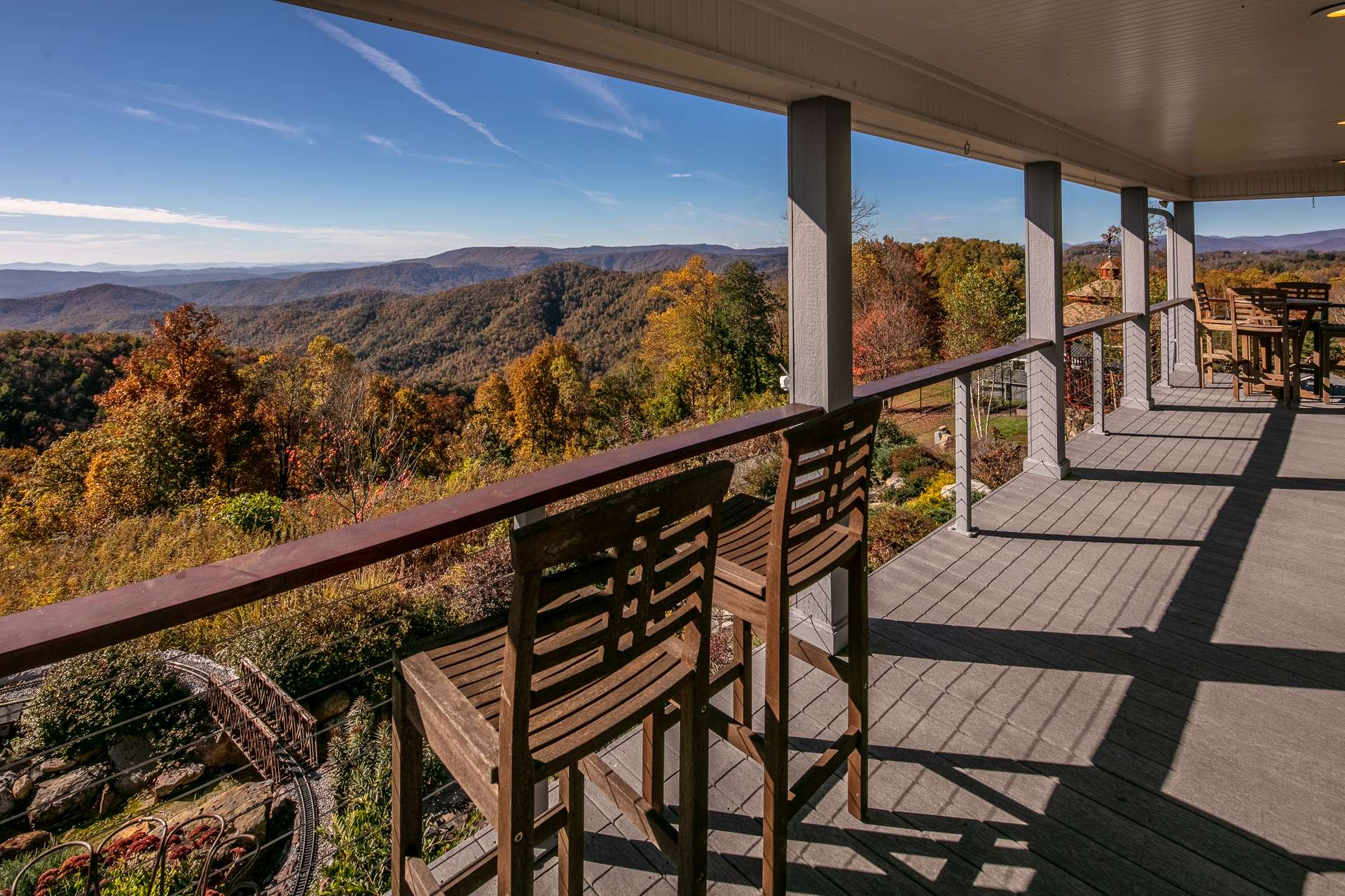 From the living area, step out onto the covered wrap porch where the beauty and majesty of the mountains greet you with an unrelenting urge to  never leave your mountaintop retreat.