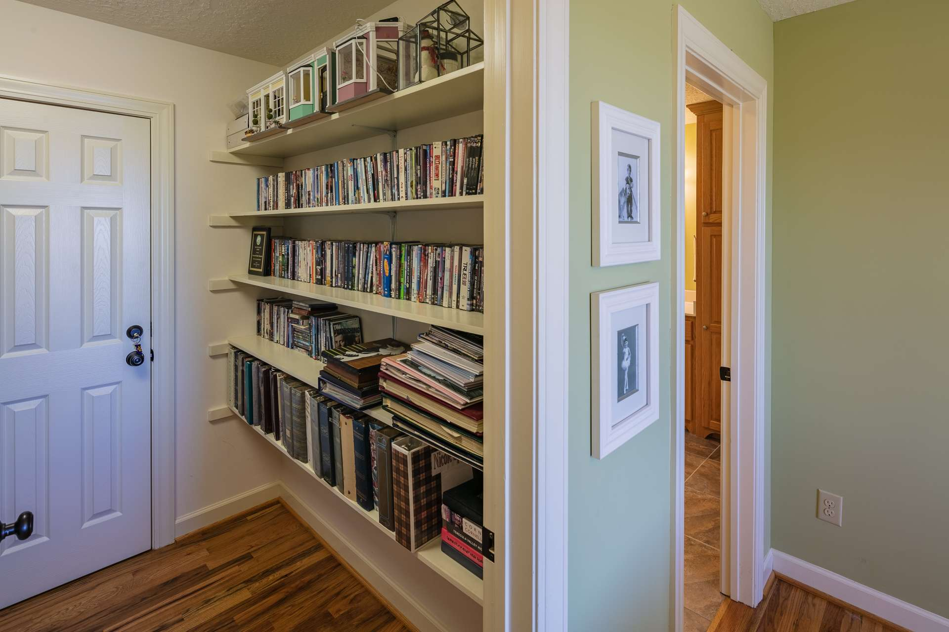 Notice the built in shelving for books or to showcase collectables.