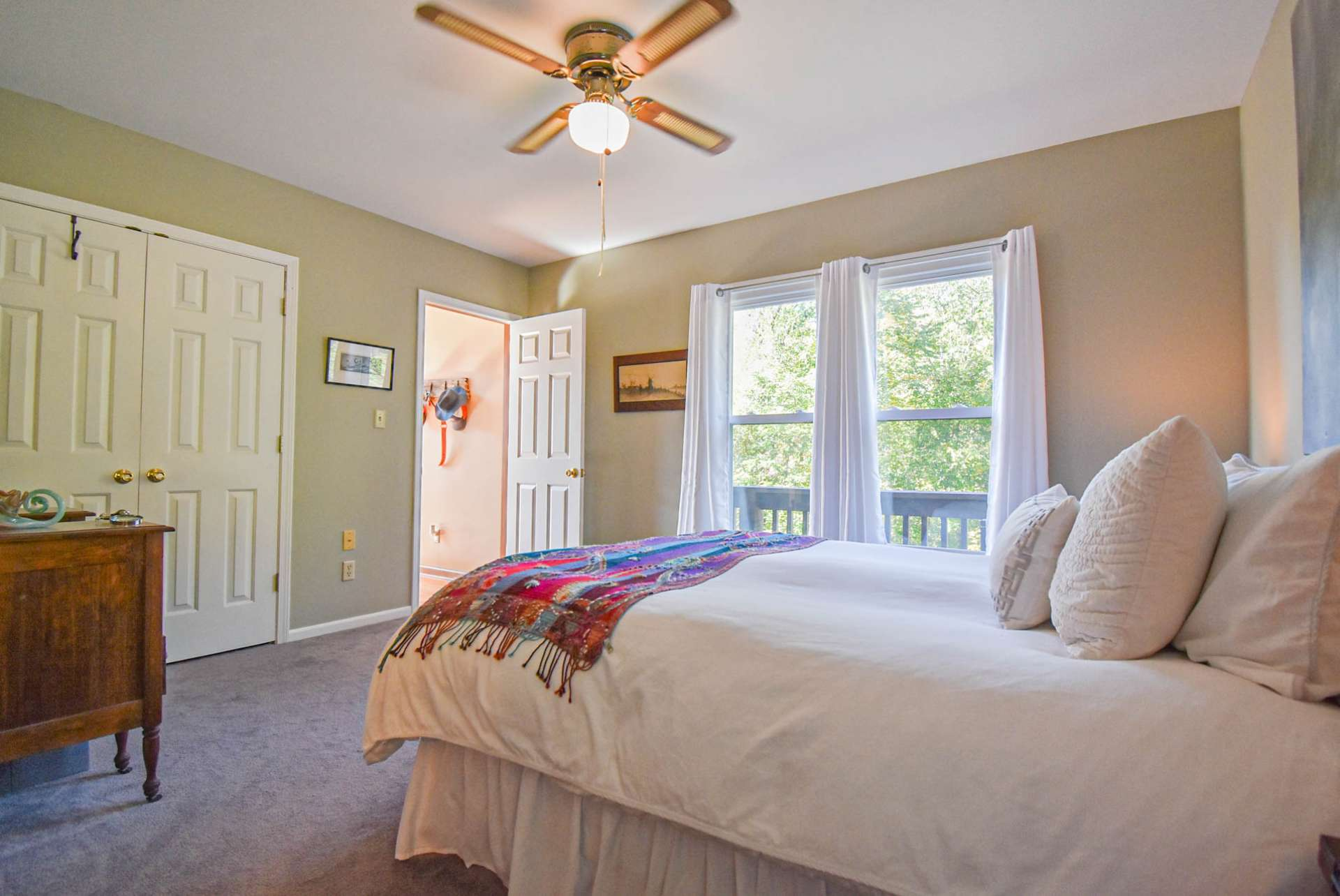 This bedroom also features plenty of natural light.