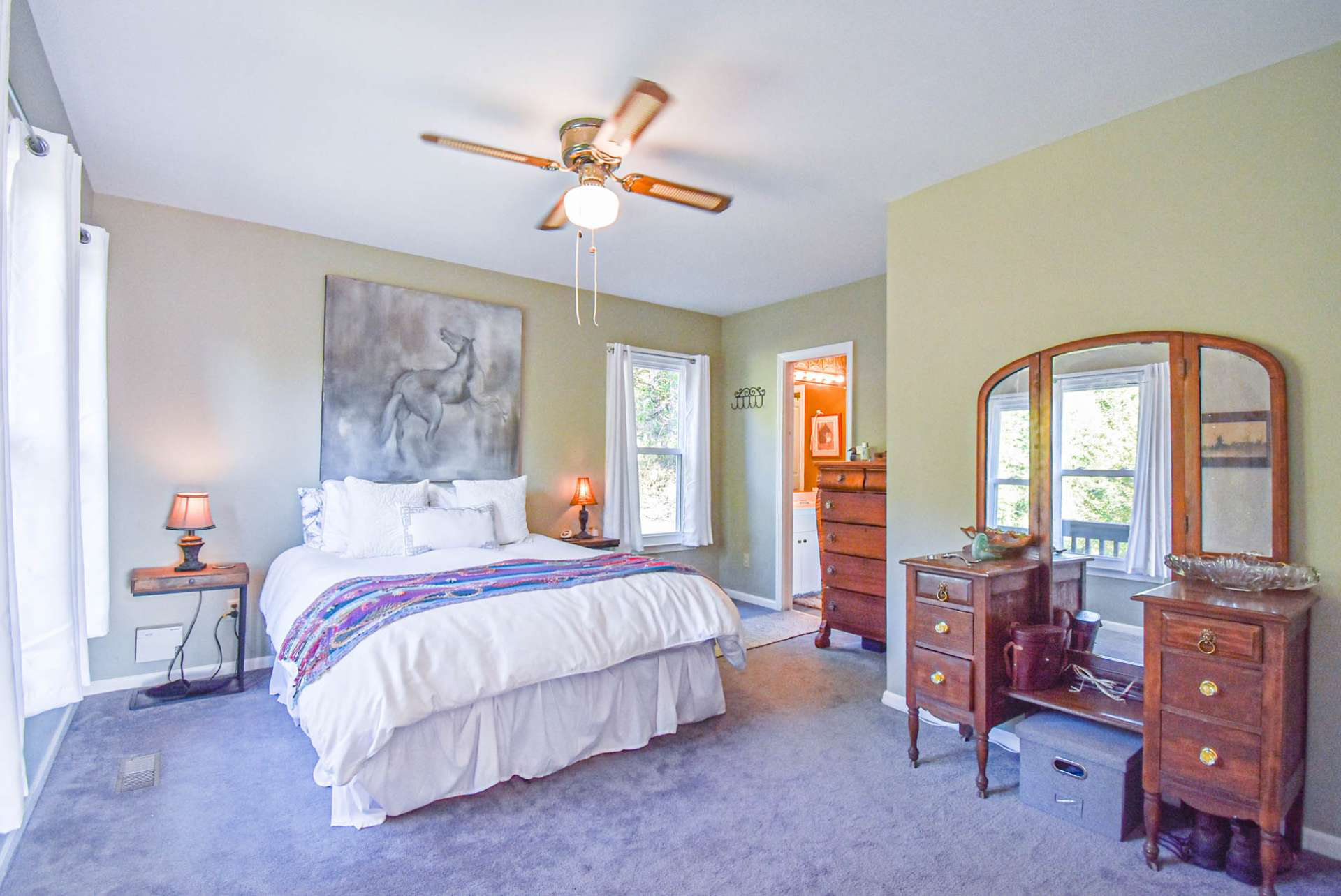 The main level offers a master suite option. This spacious bedroom features lots of light, comfortable carpeted floor, and a full bath.