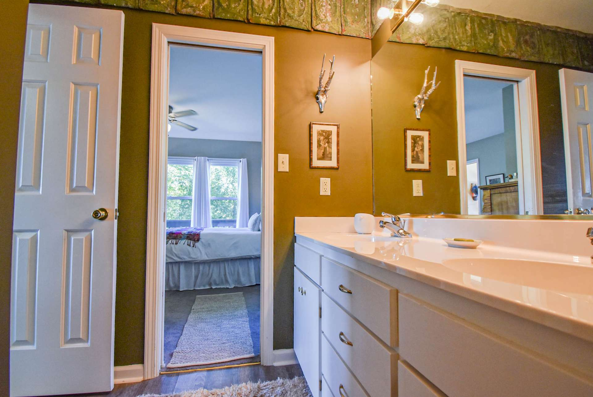 The main level features a full bath with double vanity and tub/shower combo and is accessed down the hall from the great room and from the main level bedroom creating a master suite option.