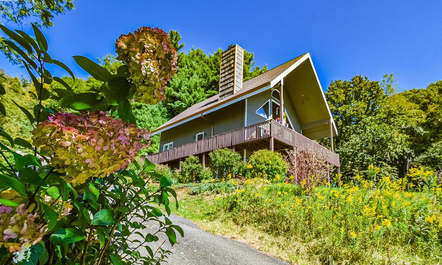 Nestled in a peaceful 7+ acre setting with a small pond, walking trails, abundant wildlife, and a diverse mixture of perennials and wildflowers, this well kept mountain chalet offers a tranquil retreat buffered by Nature.