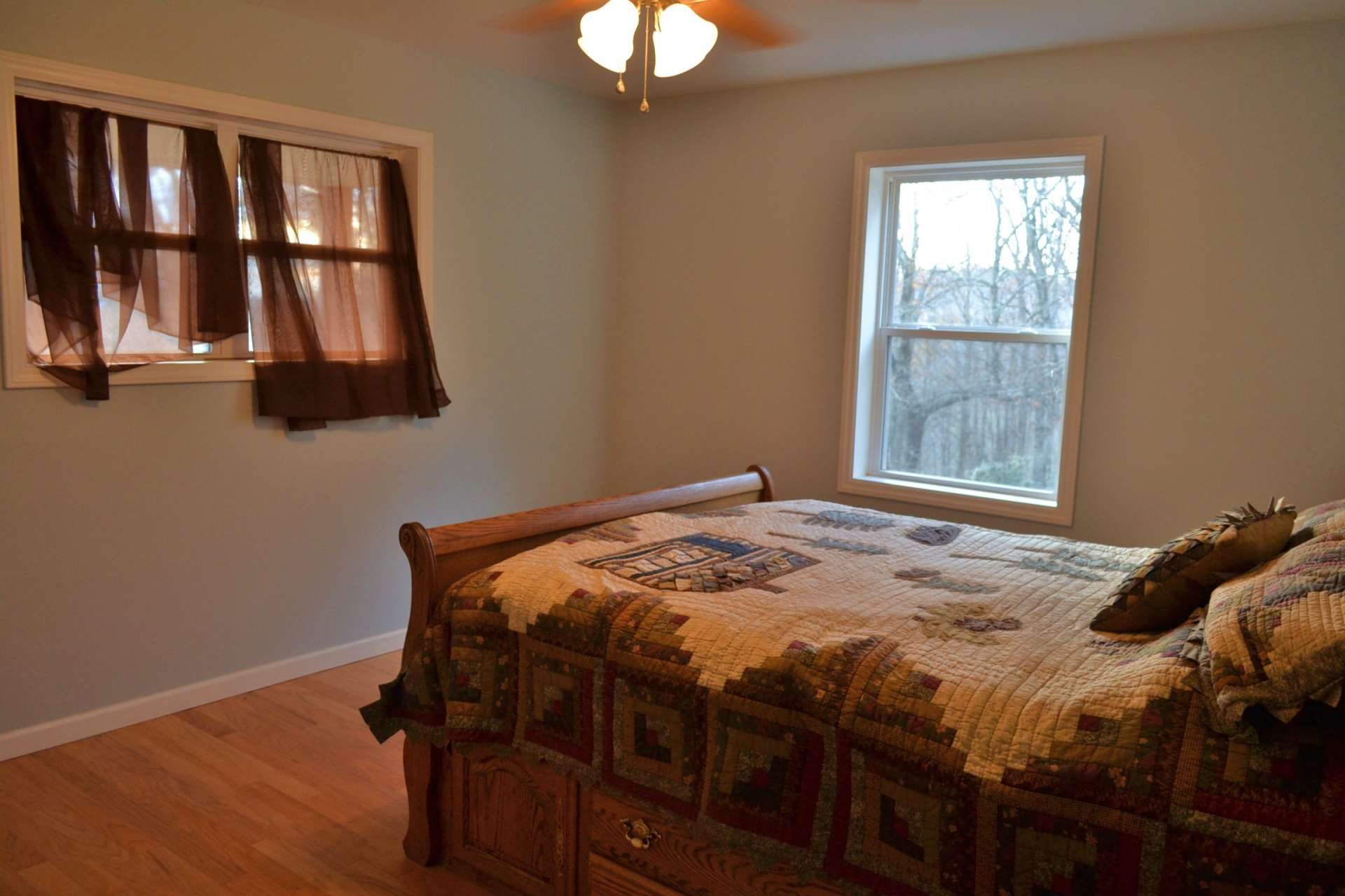This is the larger of the two bedrooms and features lots of windows to enjoy the views and mountain scenery.