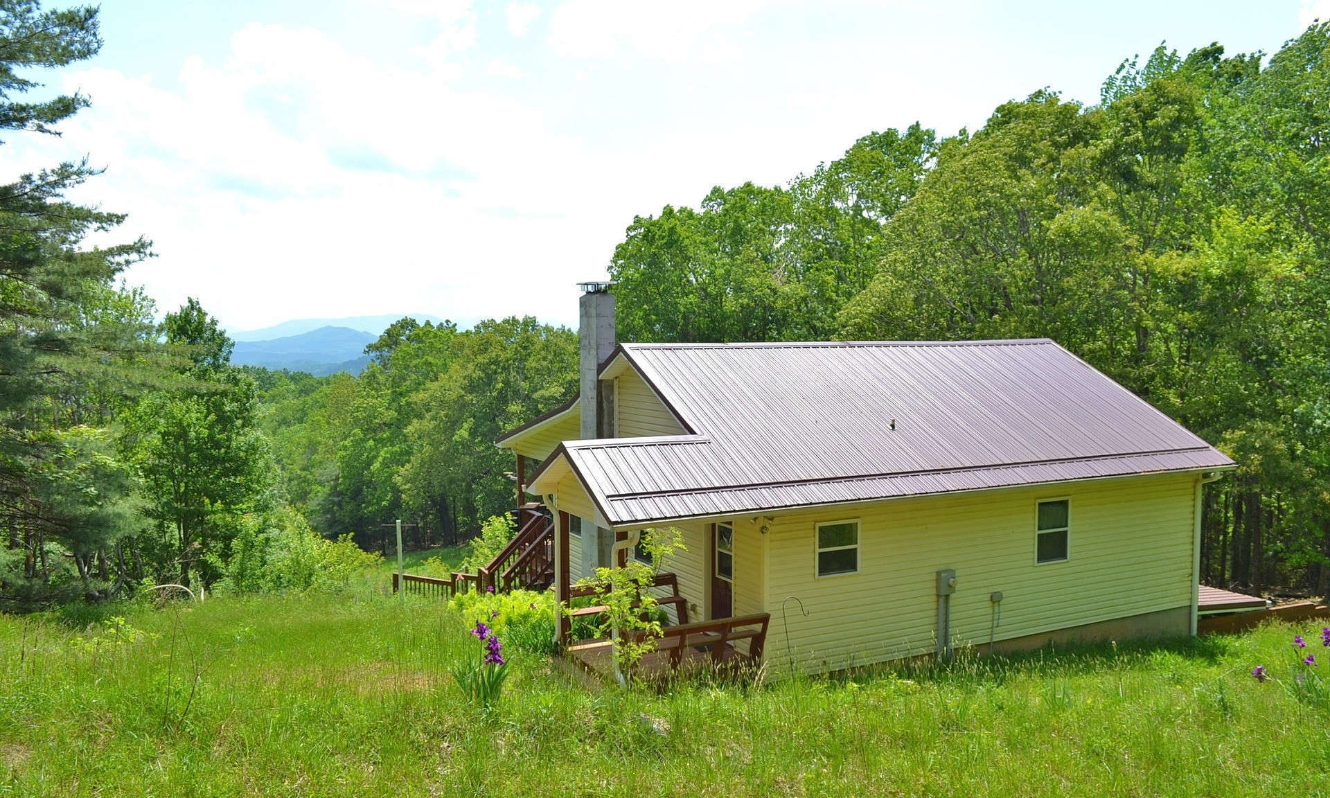 Enjoy Private mountain living and fabulous long range layered views with this sweet 2-bedroom, 2-bath mountain cottage nestled among 6.95 acres in Kindrick Mountain, a private gated community in the Mouth of Wilson area of Grayson County of Southwest Virginia.