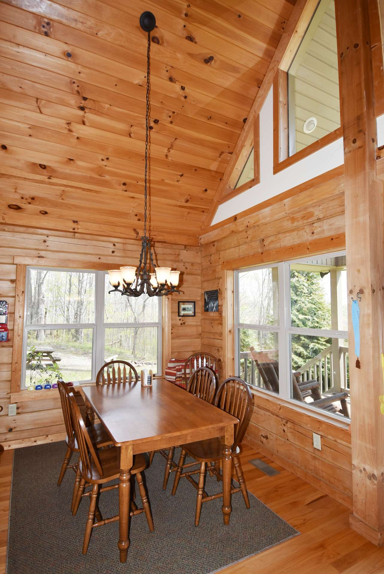 The vaulted formal dining area  embraces the outdoor scenery and views while dining inside.