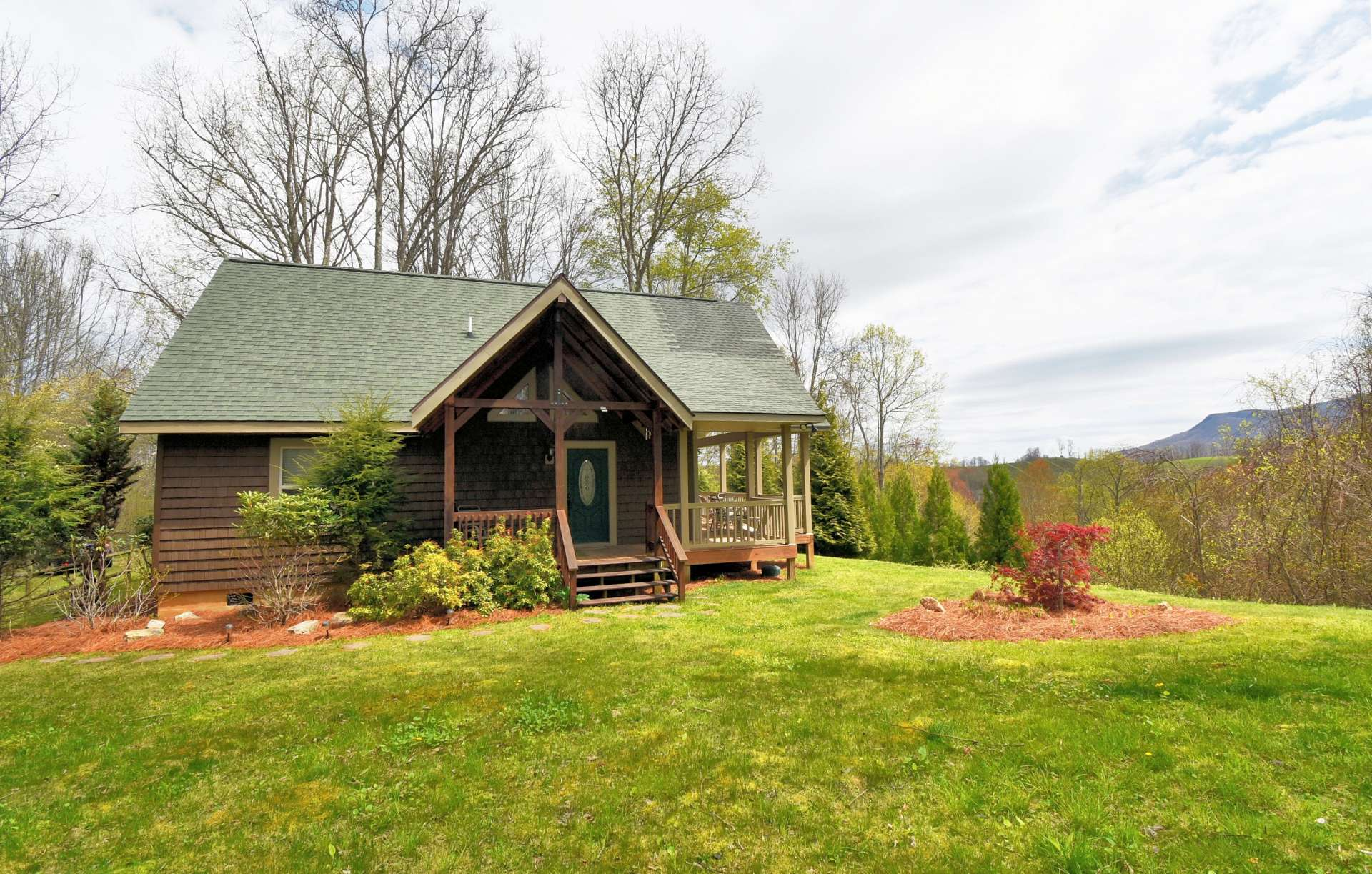 Offering a true log cabin  living experience, you will enjoy  modern conveniences, low maintenance exterior, and lovingly landscaped surroundings awaiting you here at this special place in the NC High Country.