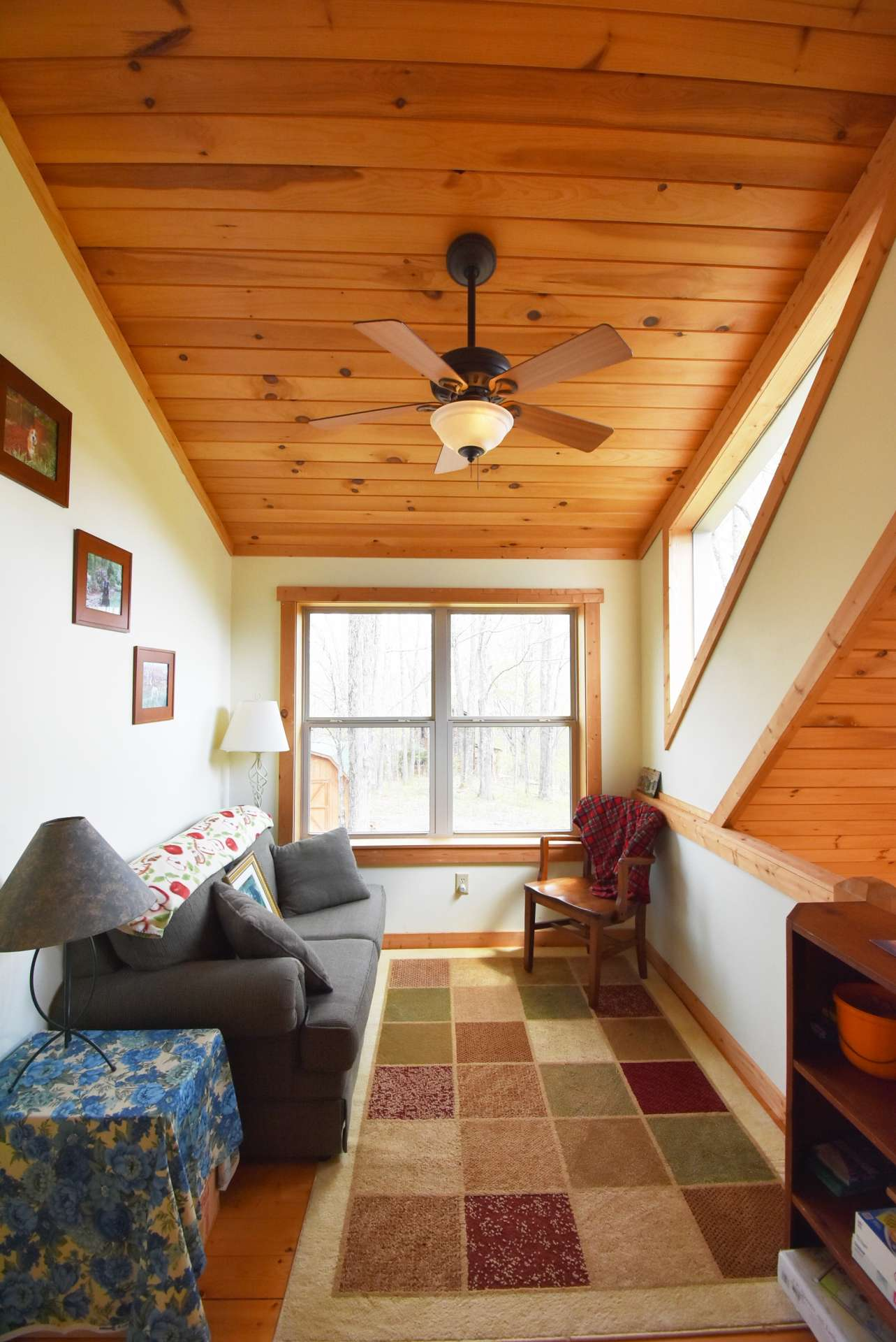 A cozy loft area overlooks the great room and the perfect place for reading or working puzzles.