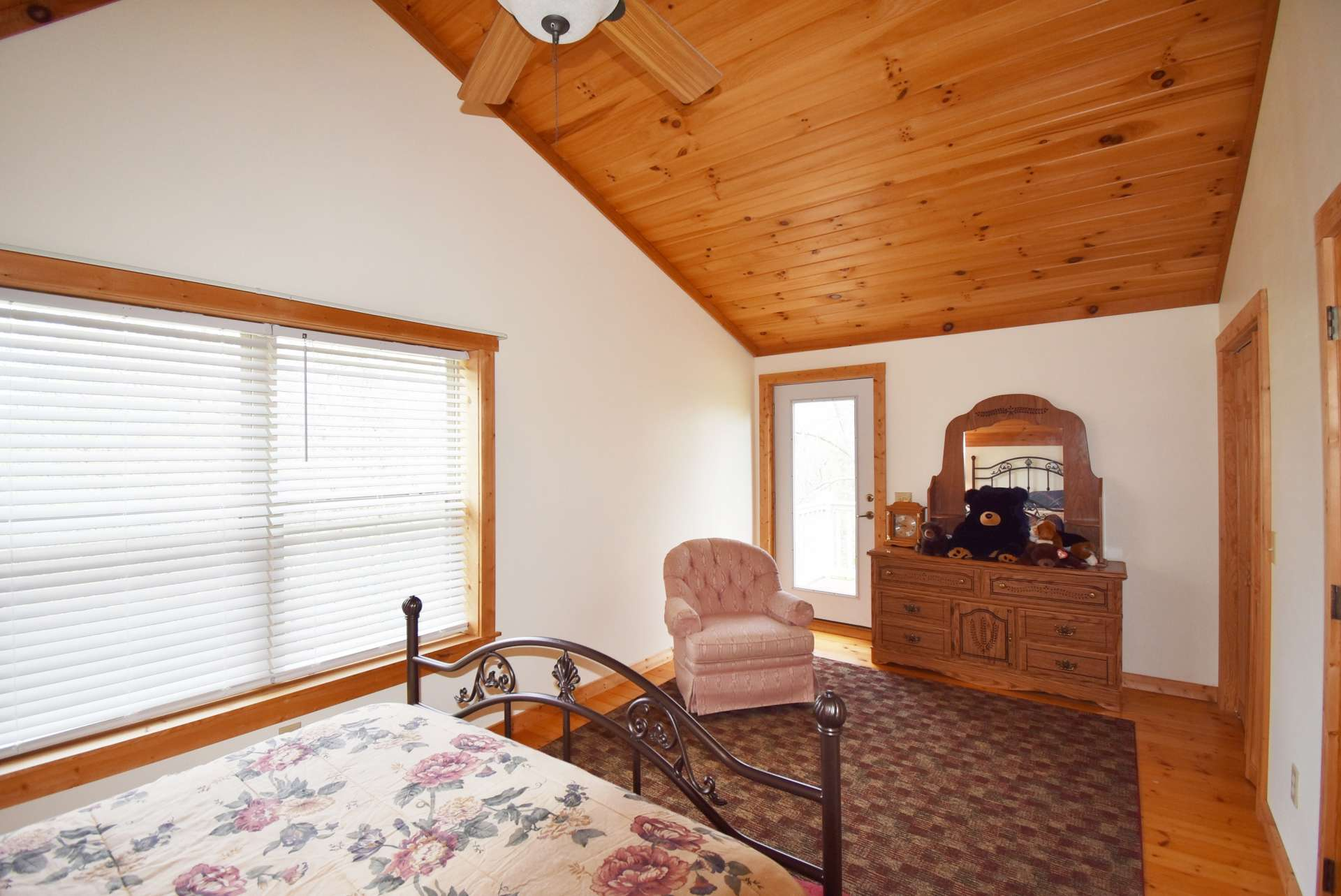 The  upper level features wood floors.  The cabin's furniture stays, with the exception of a few personal items and tools.