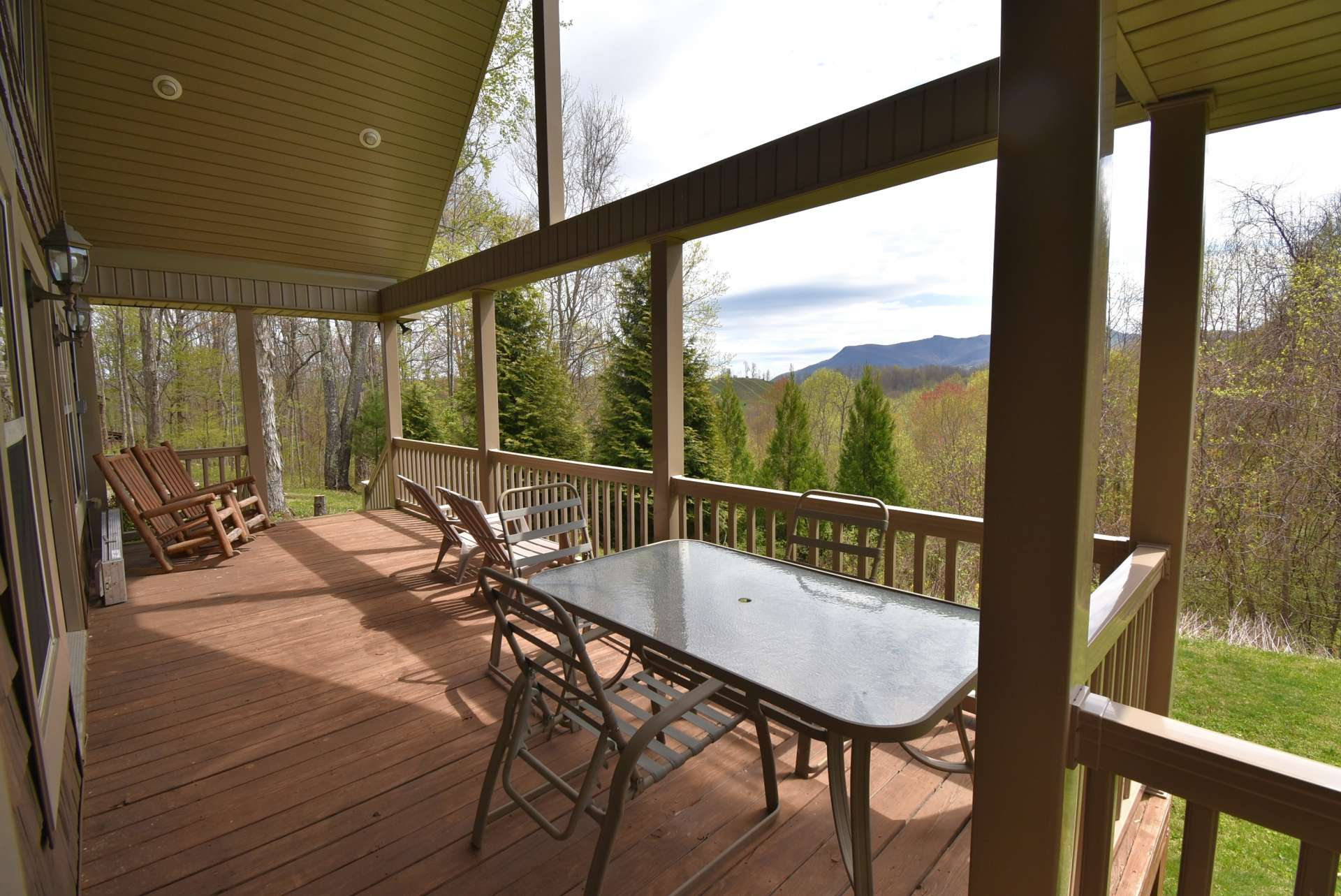 For your outdoor grilling, dining, and entertaining, this home offers a large vaulted covered porch where you will enjoy views of  Three Top Mountain and seasonal views of the Peak.