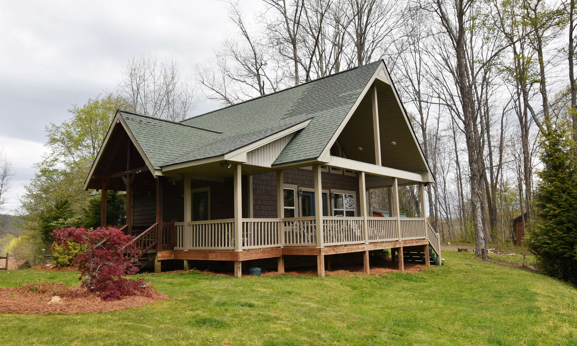 Country roads take you home to your  River Breeze log cabin with long range mountain views and cradled in a 3.73 acre setting in River Breeze Estates, a well established community offering common river access and located in the Creston area of Ashe County in the North Carolina Mountains.