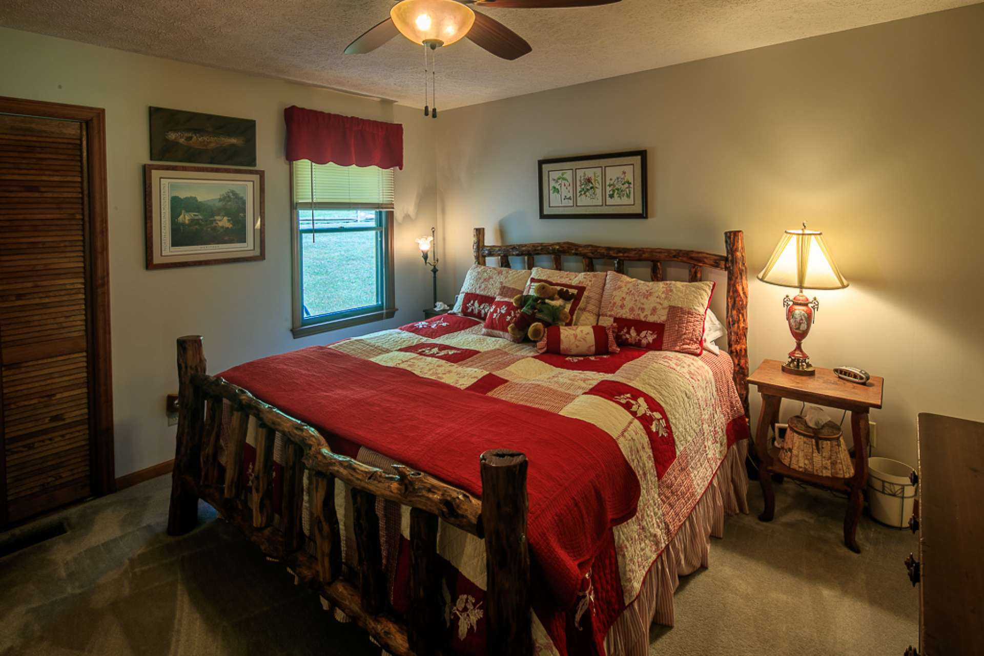 This main level master suite is spacious and features comfortable carpeted flooring.
