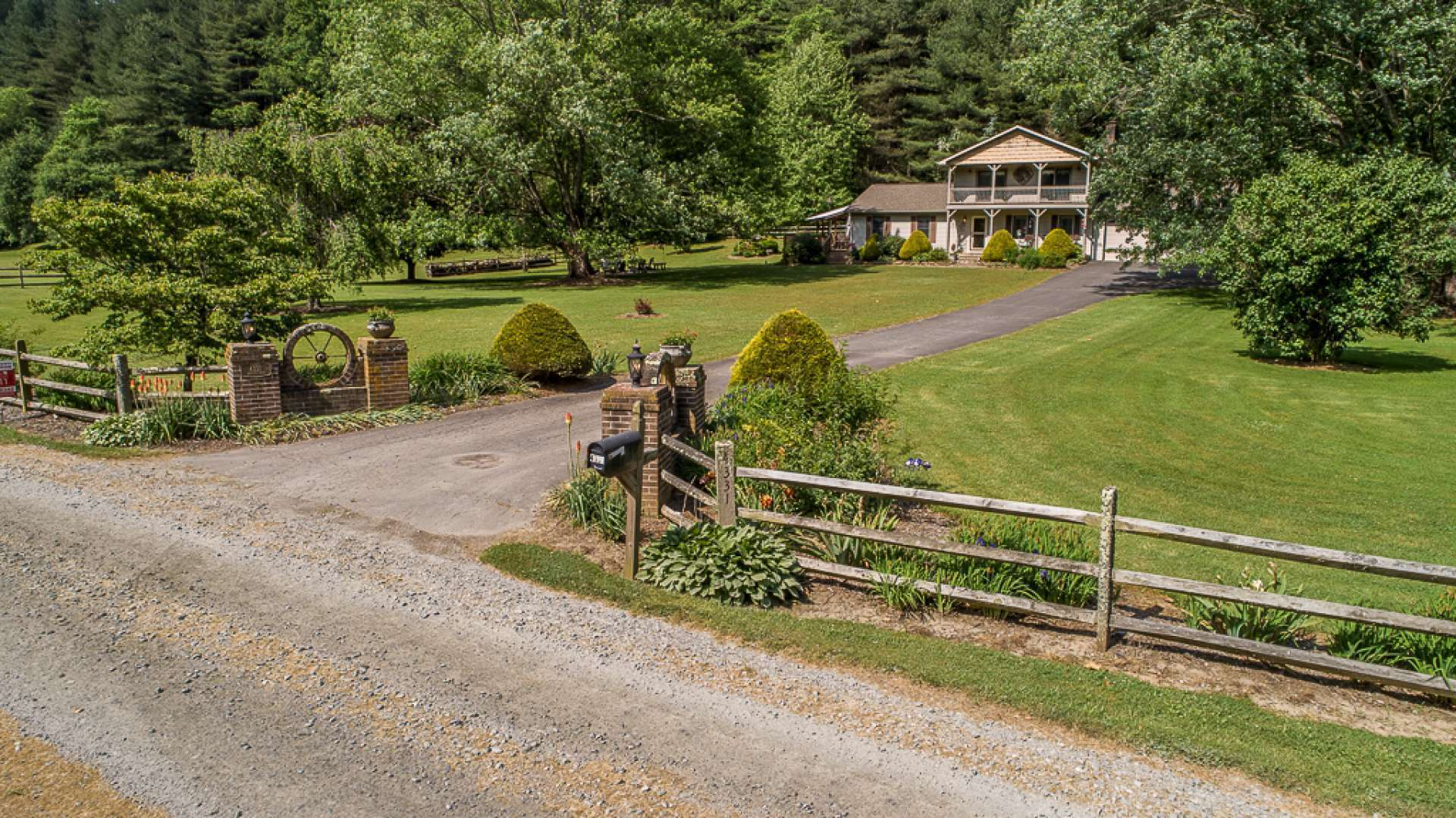 Nestled among this pristine setting is a spacious remodeled 4-bedroom, 2-bath country home accessed via a private drive.
