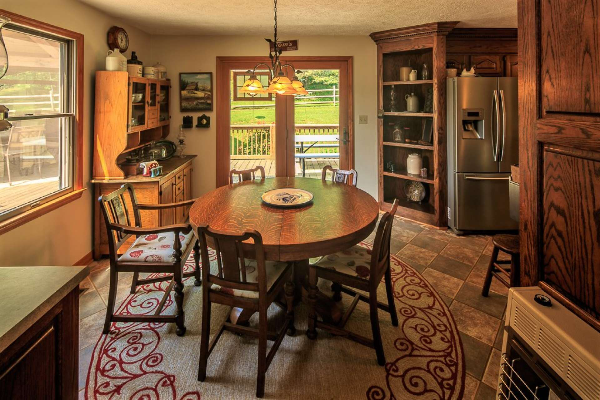 The kitchen also offers a breakfast nook or informal dining area featuring easy access to the outdoors.