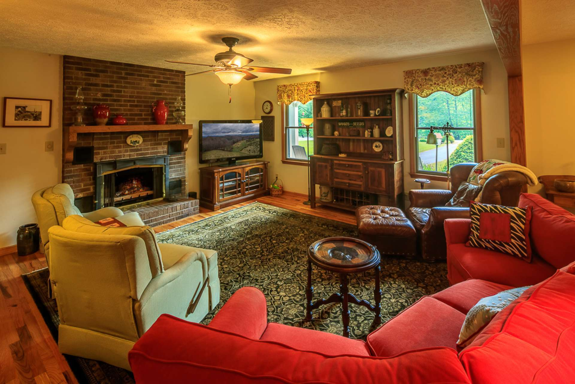 A spacious living room welcomes you and your guests to come in and experience country living in grand style.