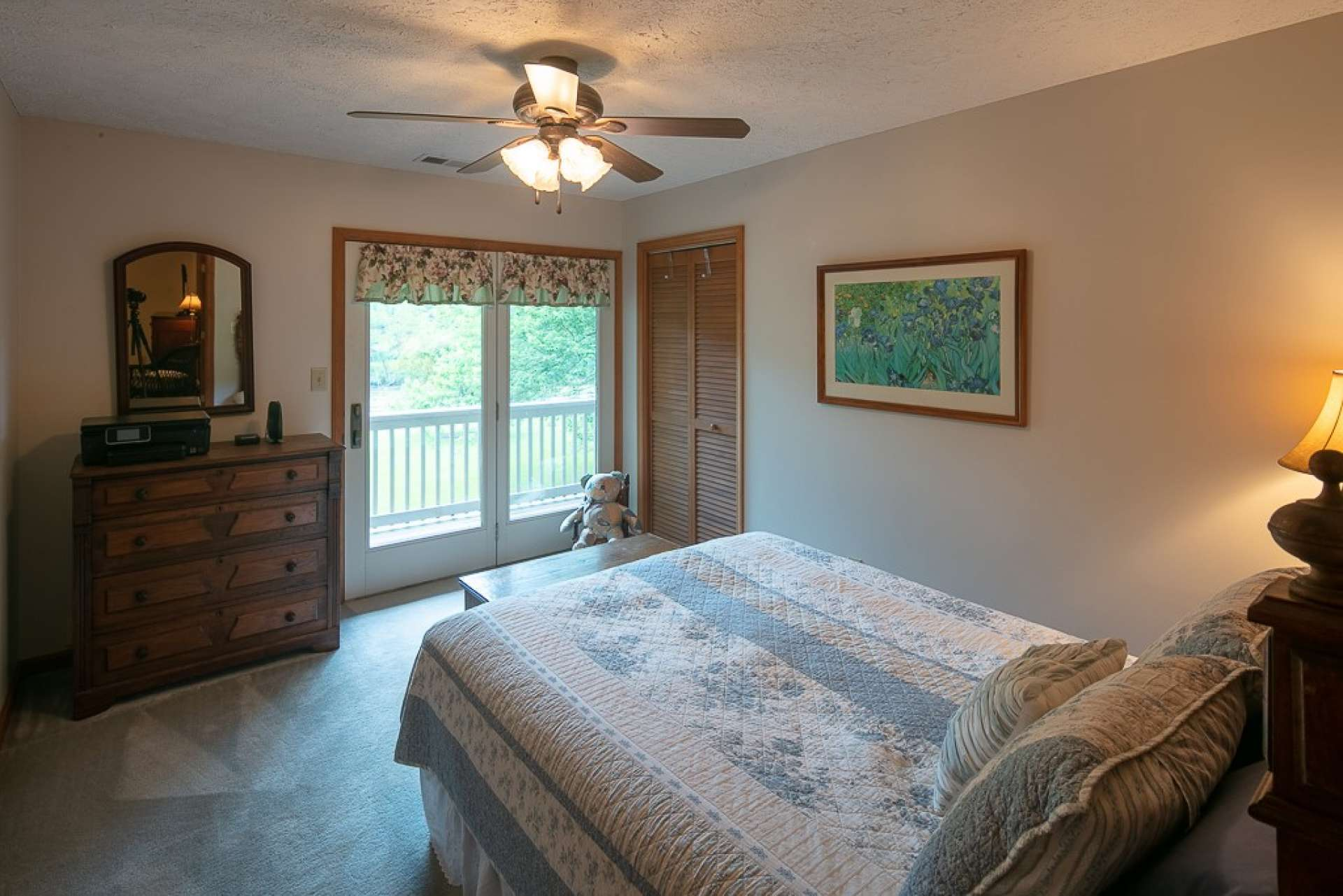 The upper level offers three bedrooms and a full bath with two vanities and tub/shower combo. This upper level bedroom has access to the upper level balcony.