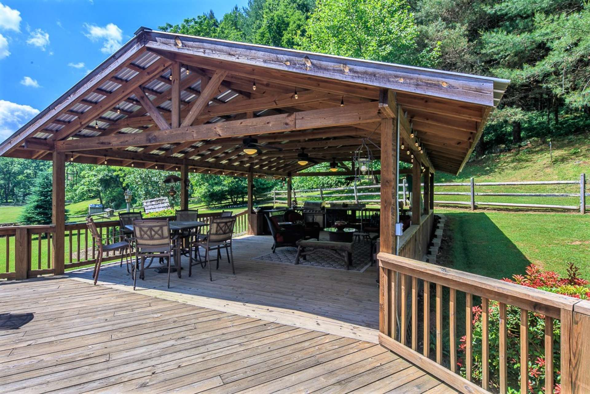 This home is an entertainers dream! In addition to the indoor entertaining space, this incredible outdoor summer kitchen offers over 600 square feet of covered entertaining space.