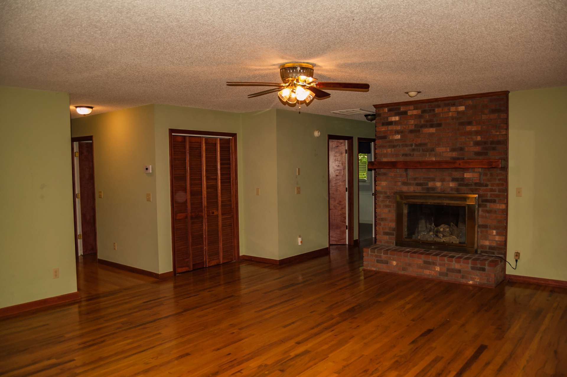 One level living offers an open floor plan with a spacious kitchen, dining and living area with hardwood floors.  The living room features a brick fireplace for added warmth on cool evenings.