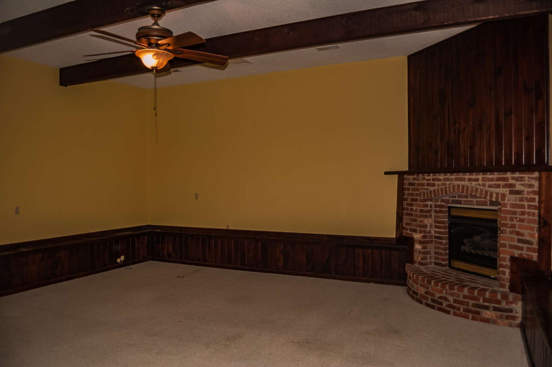Additions include this  large family or play rooom with a fireplace, and a 2-car attached garage with room for extra storage.