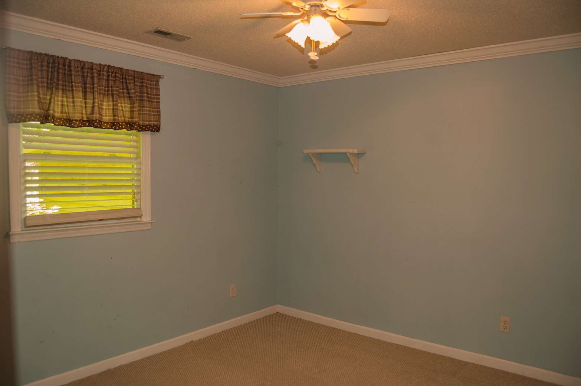 Two  additional bedrooms are amply sized and share the second full bath.