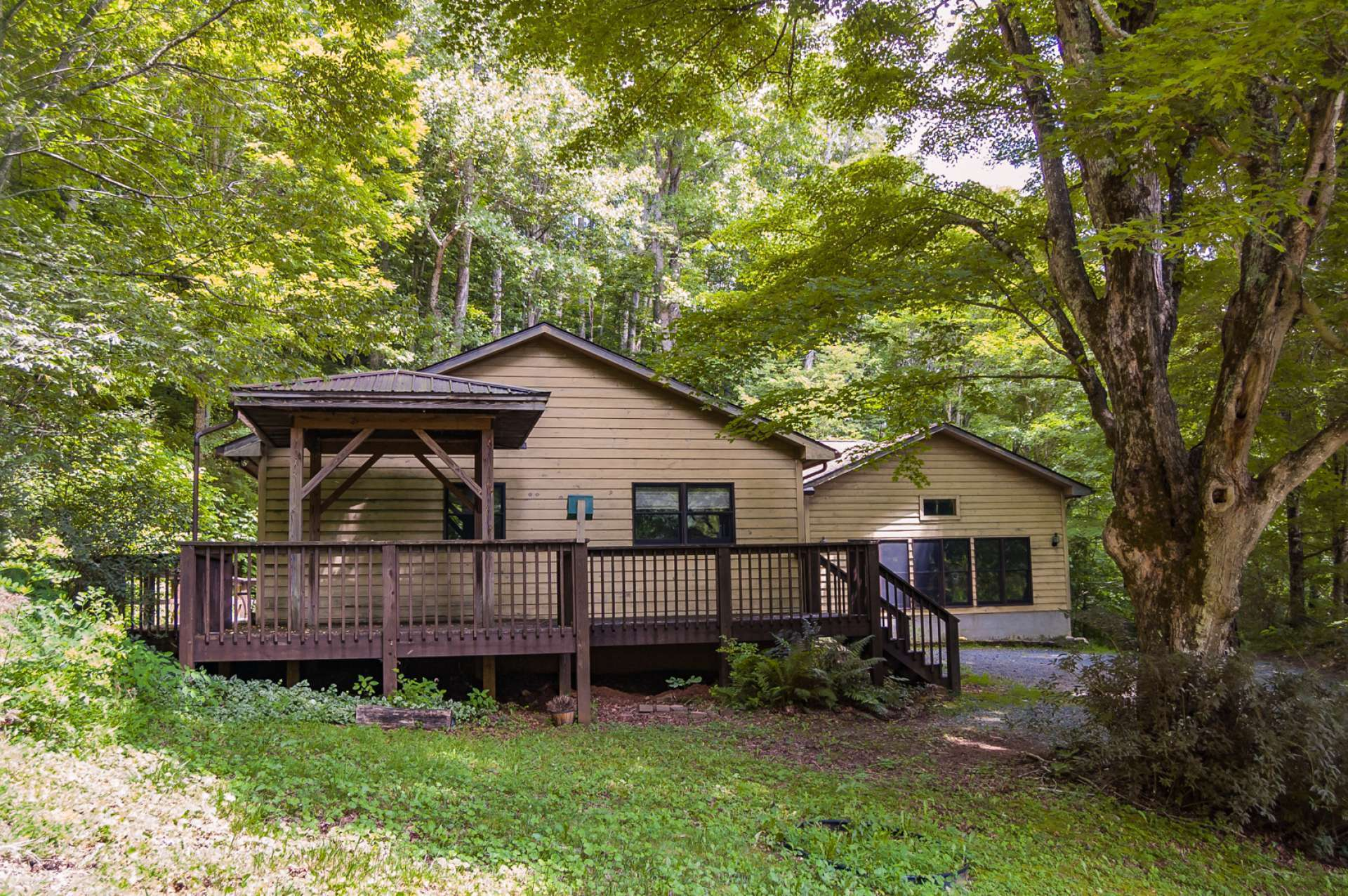 The deck is a great place to spend time enjoying mountain living.   Call today for additional information on our listing L188, the 3-bedroom, 2-bath home on 2+ acres in Southern Ashe County, NC Mountain high country.   L188