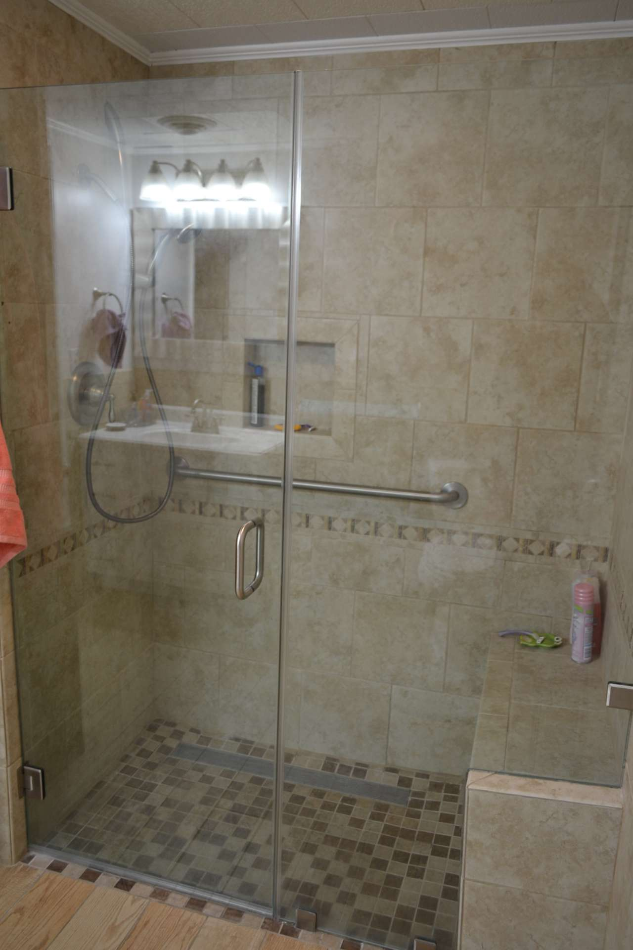 Newly upgraded tiled walk-in shower.
