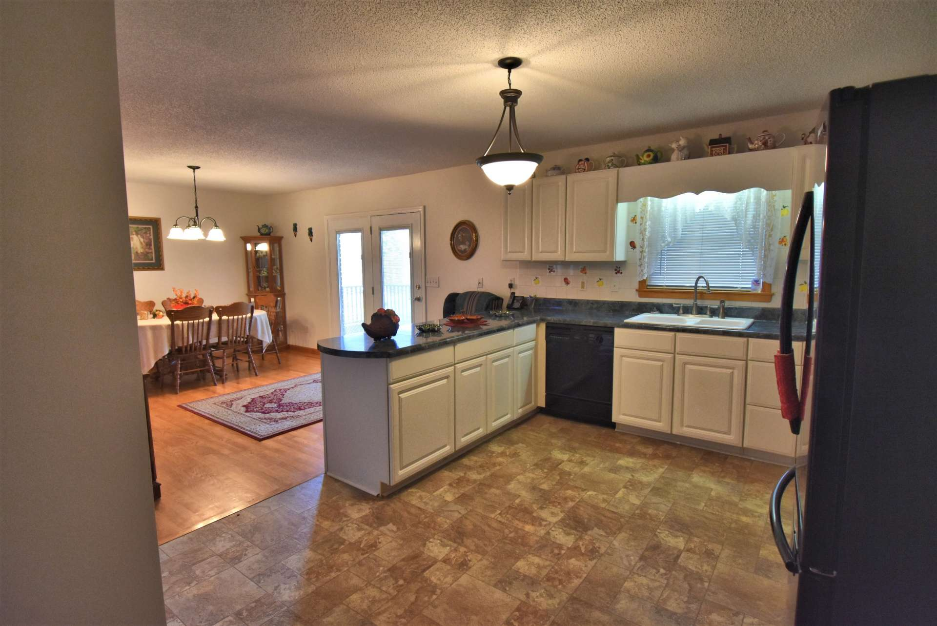 The kitchen is open to the dining area for convenience when entertaining family and friends.