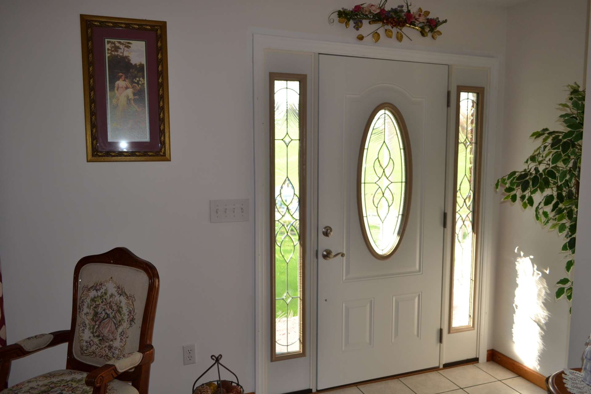 This home welcomes you and guests with lots of custom details such as this front door with beveled glass.