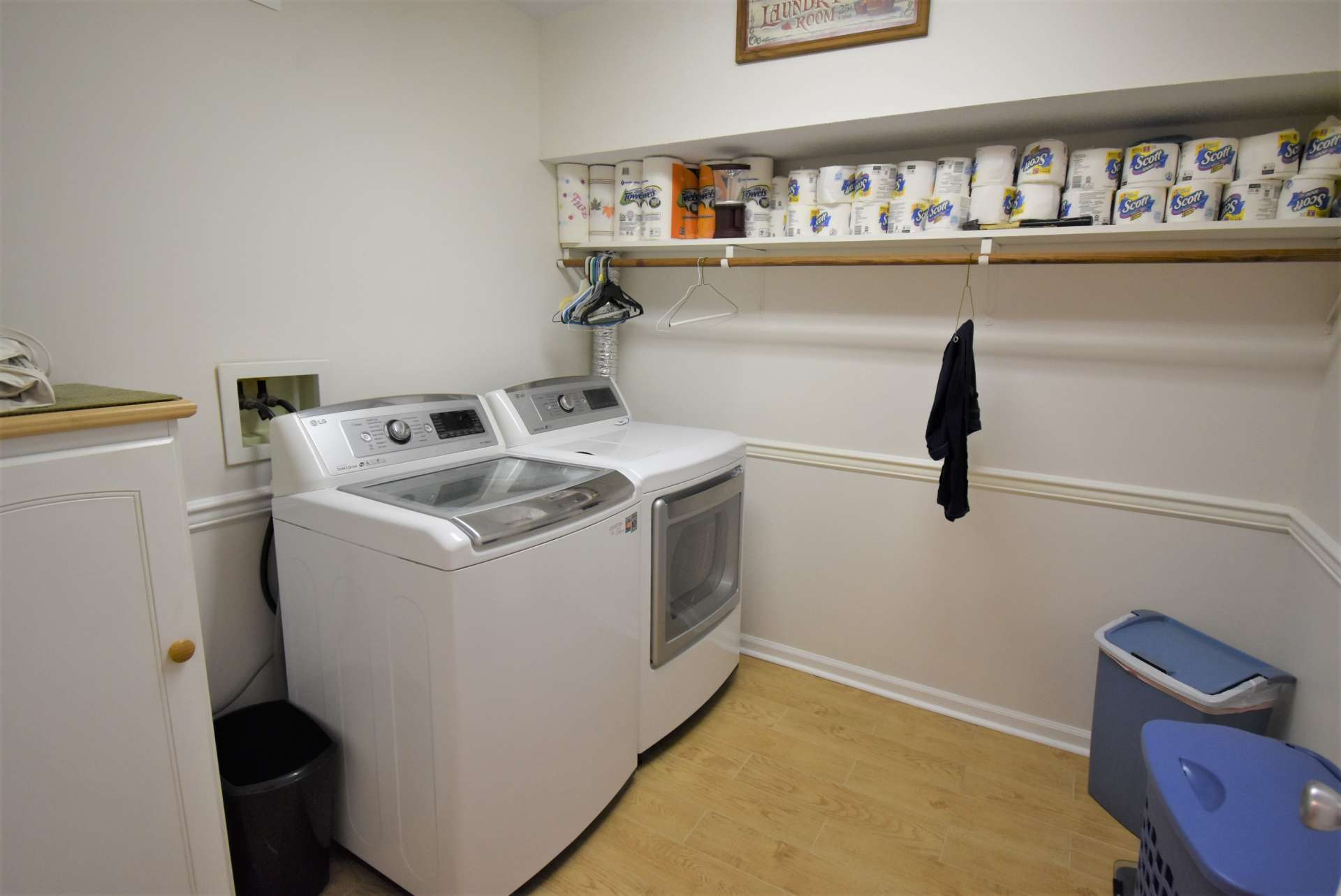 A nice sized laundry room offers additional storage space.