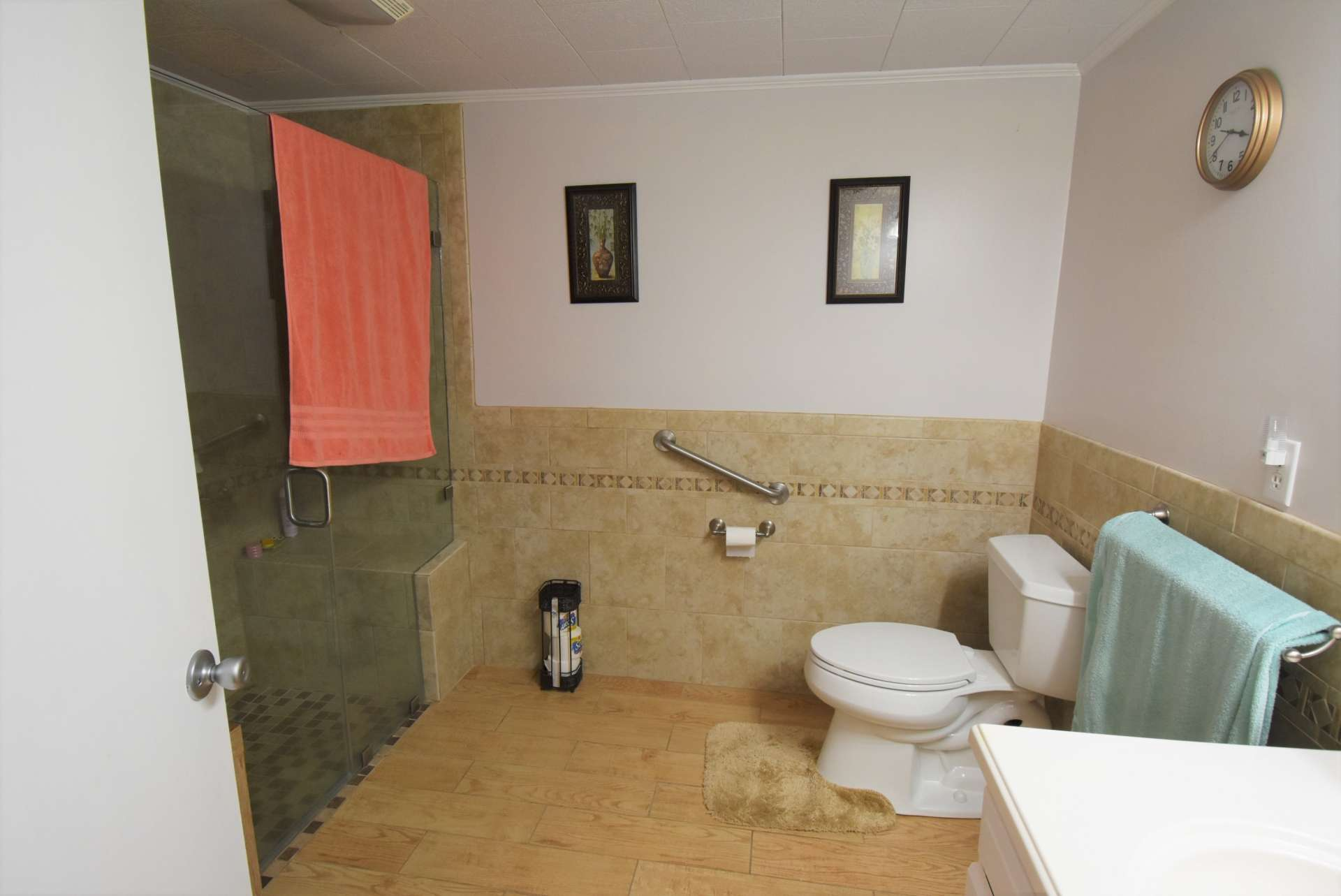 To complete the lower level is a full bath with walk-in ceramic tile shower.