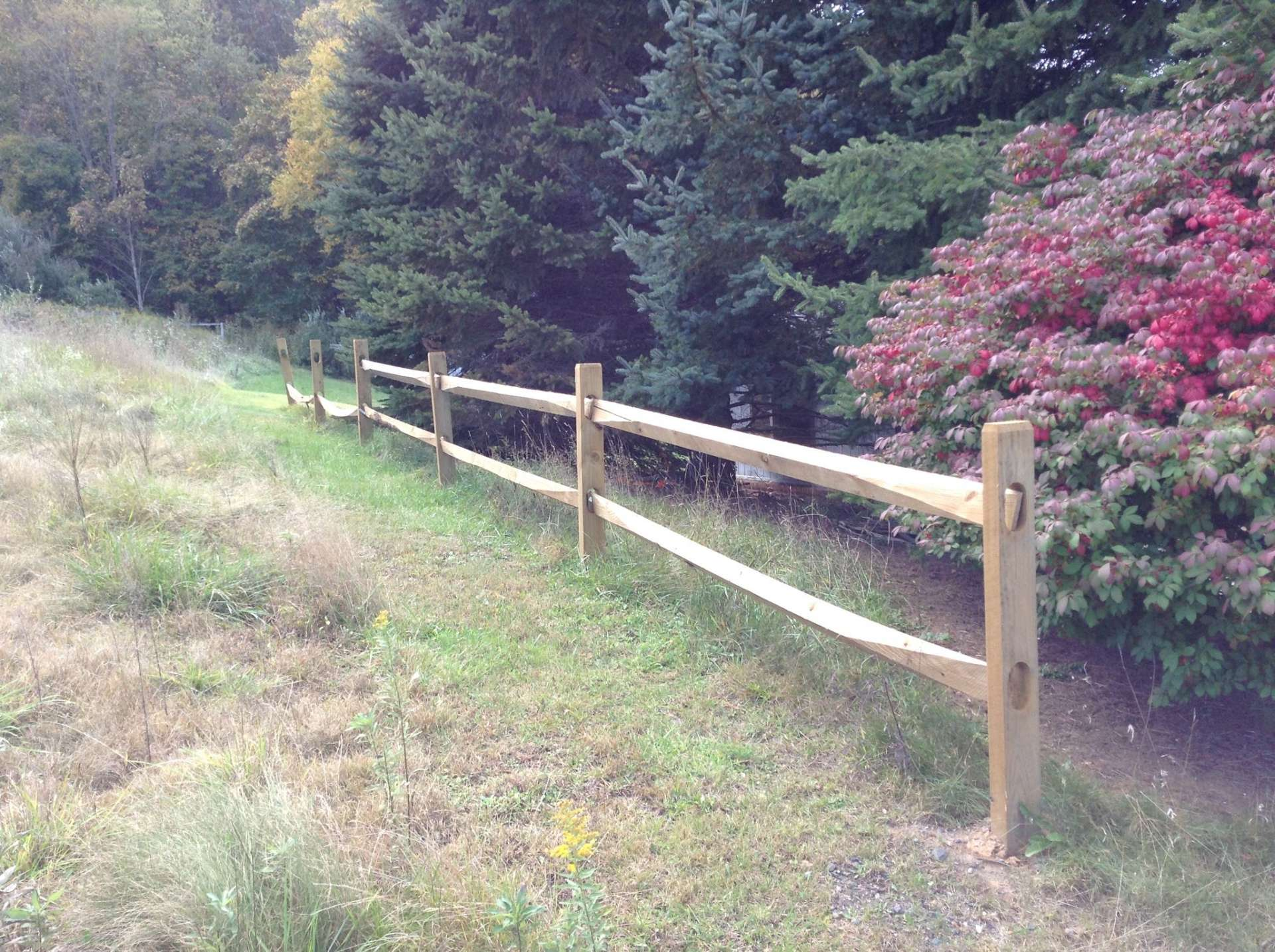 This photo provided by the owner shows a fence that runs up the land near the gate.
