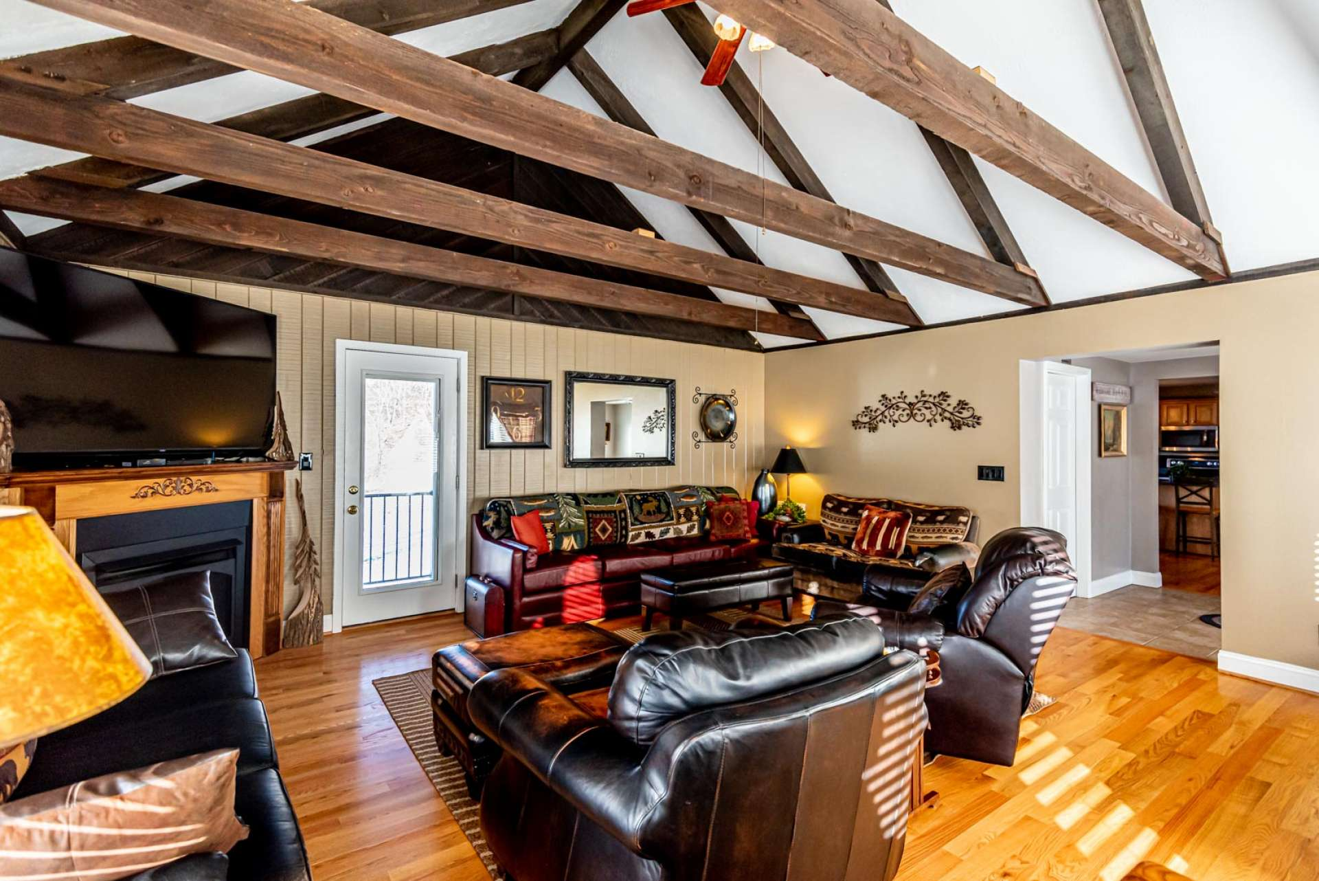 Lots of windows fill the room with natural light while the vaulted ceiling and beams add to the open feel.