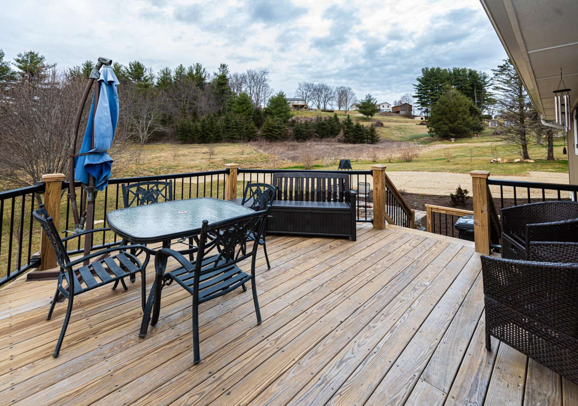 An open back deck offers privacy for outdoor grilling, dining, and entertaining.
