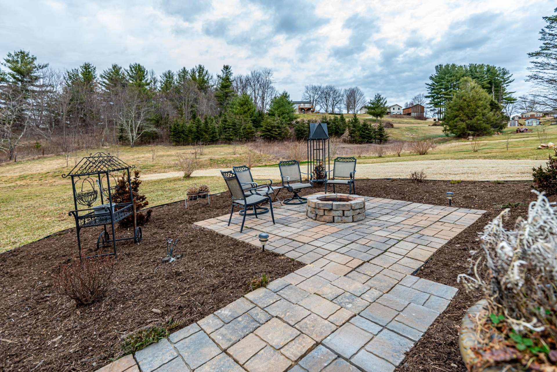 This outdoor entertaining area is perfect for sharing stories and memories around a fire in the firepit while making smores and new memories.