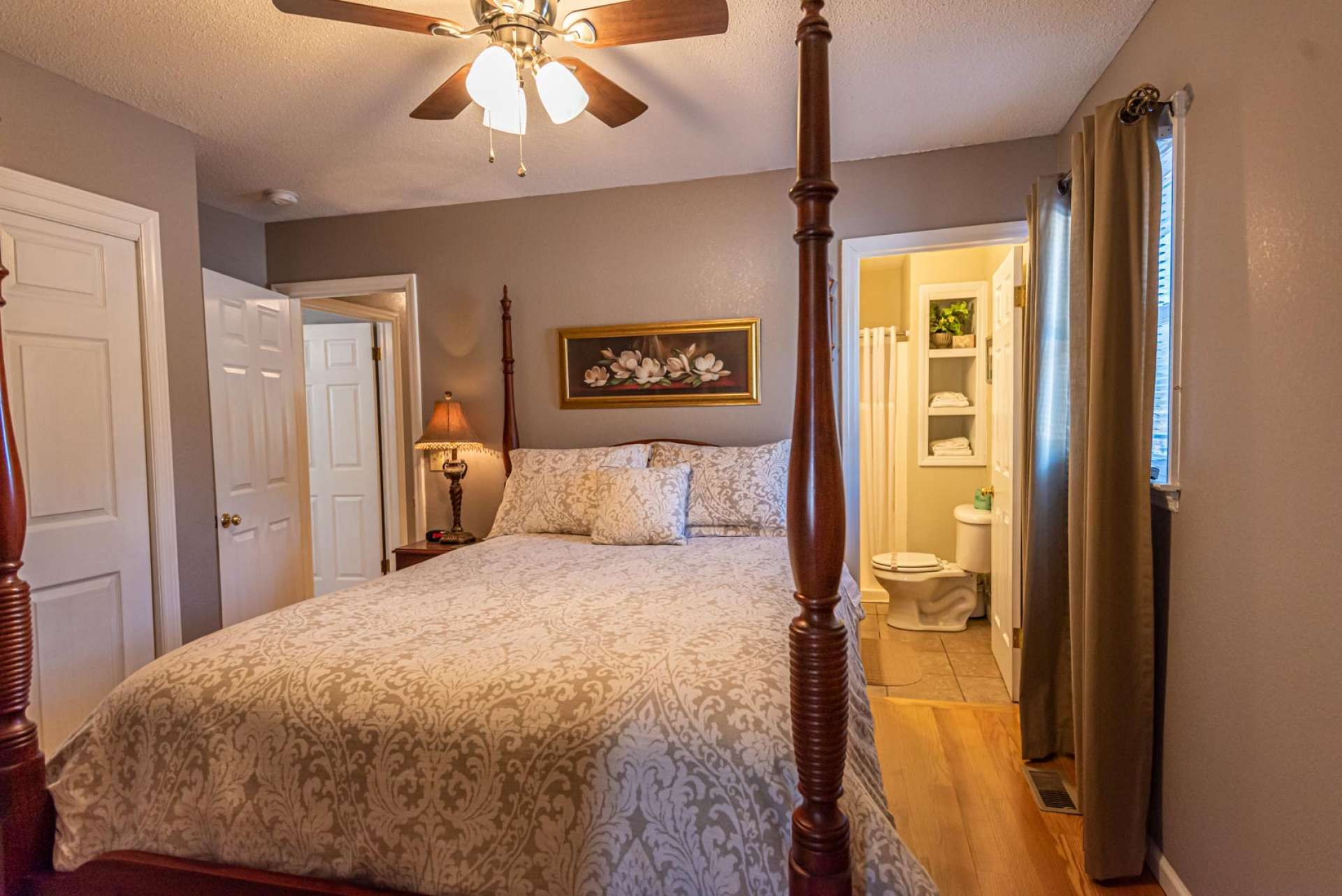 This spacious guest bedroom offers an ensuite bath and walk in closet.